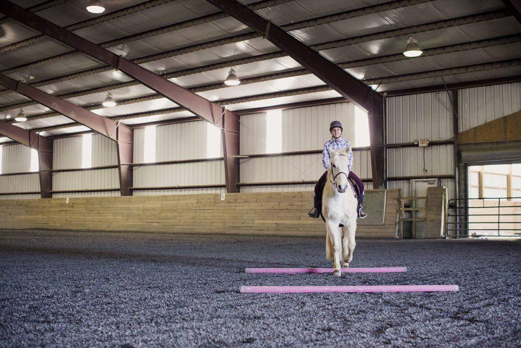 Female student riding on horse