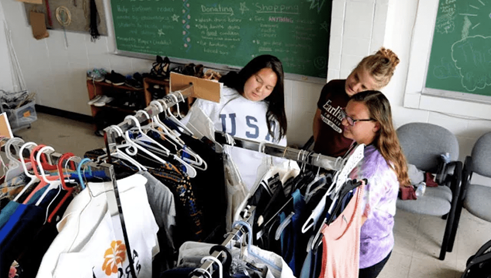 Female students looking at a free store