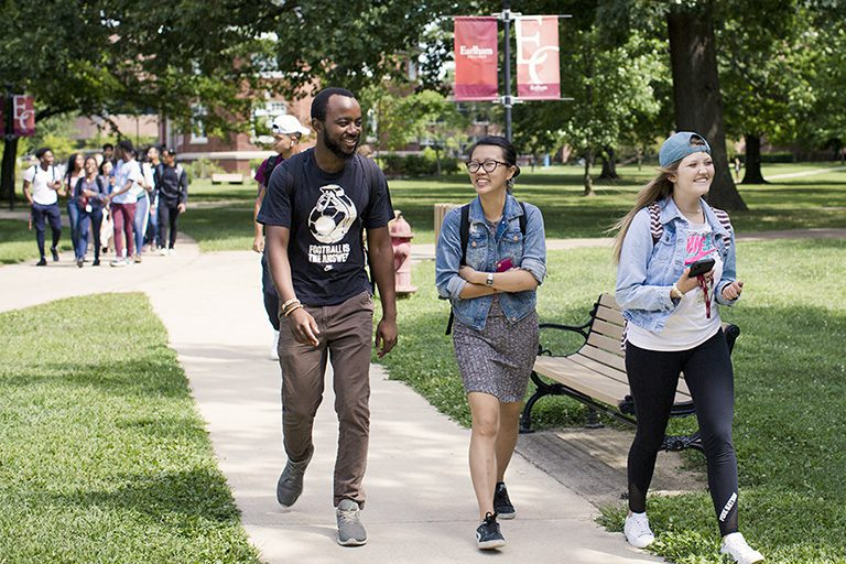 Three students walking on campus at Earlham College